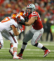 Ohio State Buckeyes defensive lineman Joey Bosa (97) gets a hold of Illinois Fighting Illini quarterback Reilly O'Toole (4) in the first half at Ohio Stadium on November 1, 2014. (Chris Russell/Dispatch Photo)