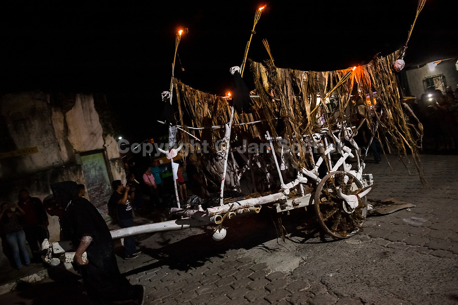 Young Salvadoran men pull a mythological cart called La Carreta Chillona during the La Calabiuza parade at the Day of the Dead celebration in Tonacatepeque, El Salvador, 1 November 2016. The festival, known as La Calabiuza since the 90s of the last century, joins Salvador's pre-Hispanic heritage and the mythological figures (La Sihuanaba, El Cipitío, La Llorona etc.) collected from the whole Central American region, together with the catholic All Saints Day holiday and its tradition of honoring the dead relatives. Children and youths only, dressed up in scary costumes and carrying painted carts, march from the local cemetery to the downtown plaza where the party culminates with music, dance, drinking and eating pumpkin (Ayote) with honey.