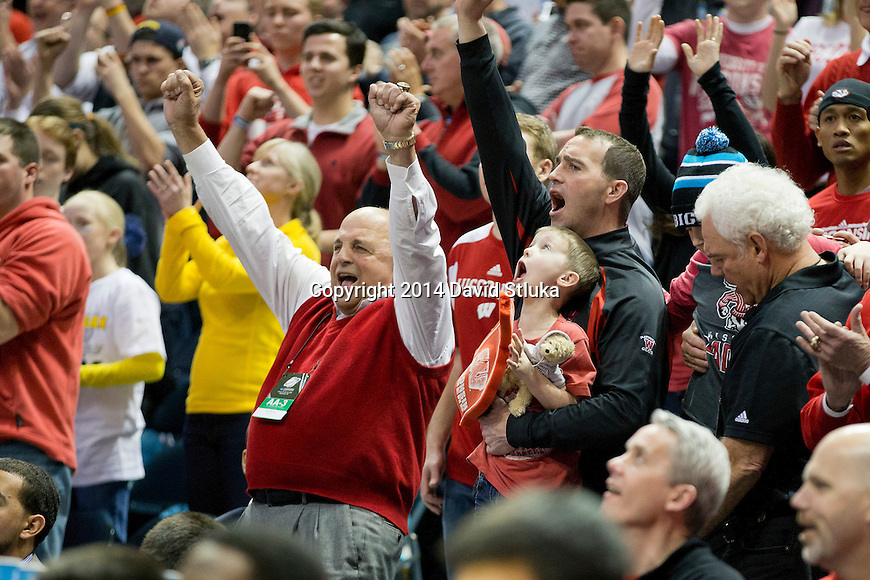 Wisconsin Badgers Athletic Director Barry Alvarez cheers with his son and grandson during the third-round game in the NCAA college basketball tournament against the Oregon Ducks Saturday, April 22, 2014 in Milwaukee. The Badgers won 85-77. (Photo by David Stluka)