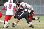 Palos Verdes, CA 09/30/11 - Michael Watkins (Lawndale #2) and Jin Matsumoto (Peninsula #40) in action during the Lawndale-Peninsula Varsity football game.