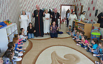Cardinal Timothy Dolan, the archbishop of New York, prays with children displaced by war in a preschool run by the Dominican Sisters of St. Catherine of Siena in Ankawa, near Erbil, Iraq, on April 9, 2016. <br /> <br /> Dolan, chair of the Catholic Near East Welfare Association, is in Iraqi Kurdistan with other church leaders to visit with Christians and others displaced by ISIS. The Dominican Sisters were themselves displaced by ISIS, and have established schools and other ministries among the displaced.