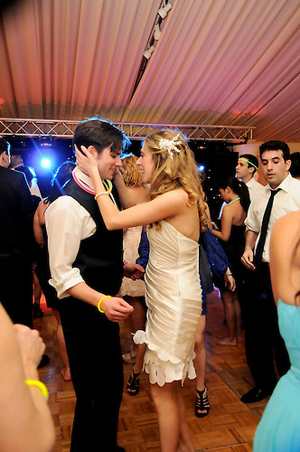 Newlweds festive happy dance during their gala wedding party at Sleepy Hollow Country Club