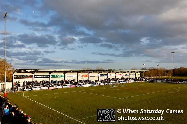 Darlington fans in the Tin Shed End as the Moon rises. Darlington 1883 v Southport, National League North, 16th February 2019. The reborn Darlington 1883 share a ground with the town's Rugby Union club. <br /> After several years of relegations, bankruptcies, and ground moves, the club is fan owned, and back on an even keel in the National League North.<br /> A 0-0 draw with Southport was marred by a broken leg and dislocated knee suffered by Sam Muggleton, Darlington's on loan left back.<br /> Both teams finished the season in lower mid table.