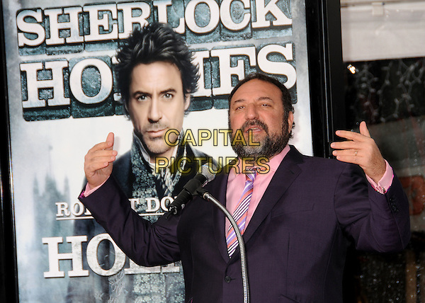 JOEL SILVER.Robert Downey Jr.'s Hand and Foot Print Ceremony held at Grauman's Chinese Theatre,  Hollywood, California, USA, .7th December 2009..half length purple suit jacket microphone speaking hands gesture funny  tie pink shirt beard facial hair .CAP/ADM/BP.©Byron Purvis/Admedia/Capital Pictures