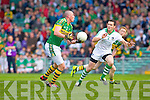 Kieran Donaghy prepares to hand pass the ball past Mark O'Riordan towards Colm Cooper in the Muster Senior Semi final held in The Gaelic Grounds last Saturday evening.