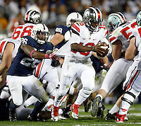 Penn State Nittany Lions linebacker Brandon Bell (26) brings down Ohio State Buckeyes quarterback J.T. Barrett (16) during the 3rd quarter of the NCAA Division I football game at Beaver Stadium in University Park, PA on October 25, 2014. (Columbus Dispatch photo by Jonathan Quilter)