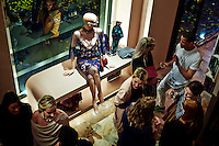 CAPE TOWN, SOUTH AFRICA - JULY 26: Guests chat after an installation show at the new Klûk CGDT flagship store during Mercedes-Benz Fashion Week on July 26, 2014, in Cape Town, South Africa. Klûk CGDT, created by the designers Malcolm KLûK and Christiaan Gabriel Du Toit. The elite of Cape Town came out for the launch of the store and the late night party. (Photo by Per-Anders Pettersson)