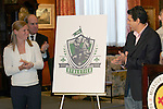 25 November 2008: Lori Chalupny, U.S. Olympic gold medalist (left) and Jorge Barcellos, St. Louis Athletica head coach and former Brazilian Women's National Team head coach (right) unveiled the WPS St. Louis team name and logo at the Missouri Athletic Club in St. Louis, Missouri.