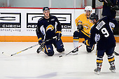 Derek Whitmore watches Andrew Orpik and Nathan Gerbe play catch. -