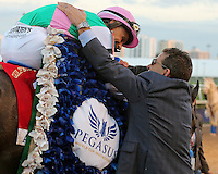 HALLANDALE BEACH, FL - JANUARY 28:  Jockey Mike Smith celebrates after winning  the Pegasus World Cup Invitational G1with Arrogate at Gulfstream Park on January 28, 2017 in Hallandale Beach, Florida. (Photo by Liz Lamont/Eclipse Sportswire/Getty Images)
