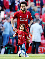 Liverpool's Mohamed Salah plays football with his daughter on the Anfield pitch at the final whistle<br /> <br /> Photographer Rich Linley/CameraSport<br /> <br /> The Premier League - Liverpool v Wolverhampton Wanderers - Sunday 12th May 2019 - Anfield - Liverpool<br /> <br /> World Copyright © 2019 CameraSport. All rights reserved. 43 Linden Ave. Countesthorpe. Leicester. England. LE8 5PG - Tel: +44 (0) 116 277 4147 - admin@camerasport.com - www.camerasport.com