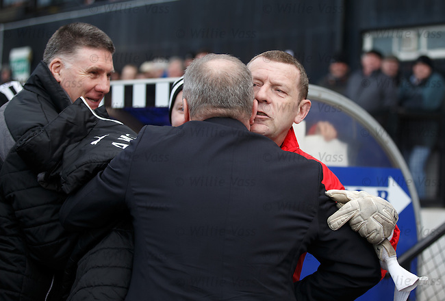 Ayr goalie coach Andy Goram whispering into Ally McCoist's ear at kick-off