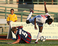 Andrew Marshall #5 of Crystal Palace Baltimore slides into Gregory Richardson #20 of the Carolina Railhawks during an NASL match at Paul Angelo Russo Stadium in Towson, Maryland on September 18 2010. Carolina won 4-2.