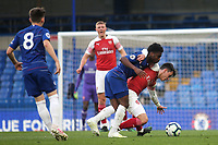 Tariq Lamptey of Chelsea and Arsenal's Robbie Burton challenge for the ball during Chelsea Under-23 vs Arsenal Under-23, Premier League 2 Football at Stamford Bridge on 15th April 2019
