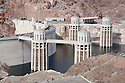 Shot from the Arizona side, Hoover Dam spans the Colorado River at the border between Nevada and Arizona. Lake Mead is the reservoir behind the dam. The dam's hydroelectric power station generates, on average, about 4 billion kilowatt-hours of power a year and is distributed to Nevada, Arizona, and California. It meets the energy needs of approximately 1.3 million people. Lake Mead is also a significant source of municipal drinking water and agricultural water for the region. Almost a decade of drought and increased water demand have brought Lake Mead near its lowest level in over 40 years. Photo taken February 2009.