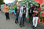 Massapequa, New York, USA. September 18, 2014. MANUEL ADOLFO VILLALOBOS, at far right, a founding member of the Alternative Hip-Hop group A Side of Darkness (A.S.O.D.), is with fellow group members and others at the Outdoor art Wallgraffiti, during Studio 5404 Art Space opening reception for art show Taking it to the Street. The show featured new works by emerging and up-and-coming local and New York artists. Studio 5404 is on the South Shore of Long Island.