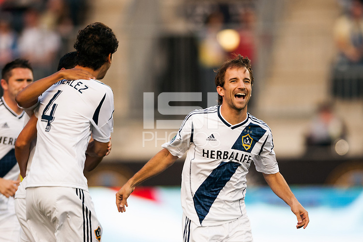 Mike Magee (18) of the Los Angeles Galaxy celebrates a goal during the first half against the Philadelphia Union during a Major League Soccer (MLS) match at PPL Park in Chester, PA, on May 15, 2013.