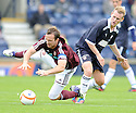 Hearts' captain Andrew Webster is caught by Rovers' Allan Walker