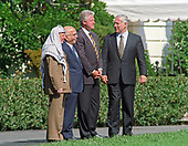 From left to right: Chairman Yassir Arafat of the Palestinian Authority, King Hussein of the Hashemite Kingdom of Jordan, United States President Bill Clinton, and Prime Minister Benyamin Netanyahu of Israel talk after leaving the Oval Office at The White House in Washington, DC following their discussions on October 1, 1996.<br /> Credit: Ron Sachs / CNP