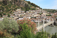 Houses in the Mangalem Quarter or Old Town and the Osum river, with the bridge linking Mangalem and Gorica, in Berat, South-Central Albania, capital of the District of Berat and the County of Berat. In July 2008, the old town (Mangalem district) was listed as a UNESCO World Heritage Site. Picture by Manuel Cohen