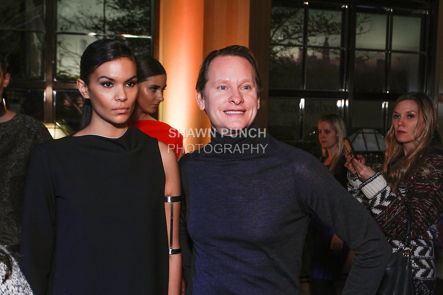 Carson Kressley poses with model at the Vassa & Co. Pre-Fall 2014 The Black Square collection by Vassa, at The Four Seasons Hotel in New York City, November 19, 2013.