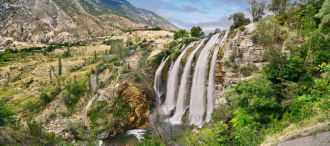 Pictures & Images of the Tortum Water Falls, Coruh Valley, Erzurum in the Eastern Anatolia, Turkey.<br /> <br /> The Tortum water falls are the largest in turkey with a drop of 164 feet (50 m) and 15 meters wide. Geologists believe they were formed in the Quaternary period by a massive landslide which blocked the deep steep sided Tortum Valley. This resulted in the formation of Tortum Lake which is 8 km long, 1 km wide and 100 meters deep.