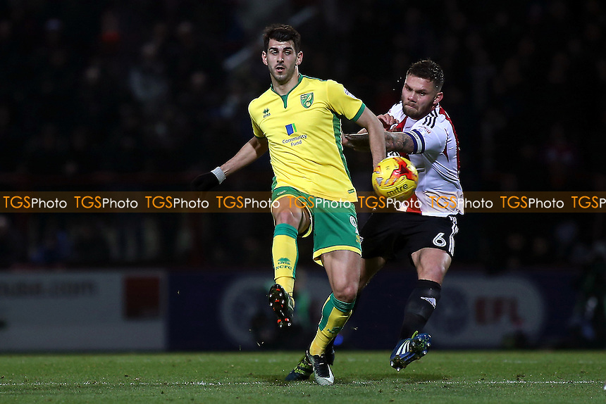 Nelson Oliveira of Norwich controls the ball under pressure from Brentford's Harlee Dean during Brentford vs Norwich City, Sky Bet EFL Championship Football at Griffin Park on 31st December 2016
