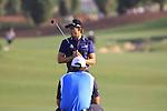 Camilo Villegas and Padraig Harrington on the 18th green during  Day 3 at the Dubai World Championship Golf in Jumeirah, Earth Course, Golf Estates, Dubai  UAE, 21st November 2009 (Photo by Eoin Clarke/GOLFFILE)