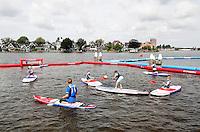 Nederland Zaandam 2016 07 09.  Ruim 300 kinderen doen mee aan de Zaanse editie van Optimist on Tour. Ze kunnen leren zeilen in een optimist, kanovaren, suppen en surfen. Het evenement bij de Zaanse Schans is de grootste Optimist on Tour ooit voor organisator het Watersportverbond. Kinderen krijgen sup les.  Foto Berlinda van Dam / Hollandse Hoogte