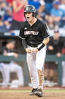 Louisville Cardinals catcher Henry Davis (32) celebrates scoring a run during Game 12 of the NCAA College World Series against the Vanderbilt Commodores on June 21, 2019 at TD Ameritrade Park in Omaha, Nebraska. Vanderbilt defeated Louisville 3-2. (Andrew Woolley/Four Seam Images)