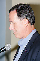Former Pennsylvania senator and Republican presidential candidate Rick Santorum speaks to an audience at the Concord office of New England College in Concord, New Hampshire.