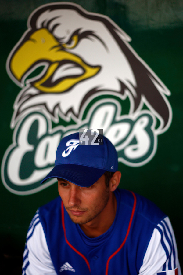25 June 2011: Laurent Andrades of Team France. Illustration of a photographic essay called Life in the dugout, during Czech Republic 11-1 win over France, at the 2011 Prague Baseball Week, in Prague, Czech Republic.