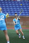 Gianna Bowe (21) of the North Carolina Tar Heels passes the ball during first half action against the High Point Panthers at Vert Track, Soccer & Lacrosse Stadium on February 16, 2018 in High Point, North Carolina.  The Tar Heels defeated the Panthers 14-10.  (Brian Westerholt/Sports On Film)