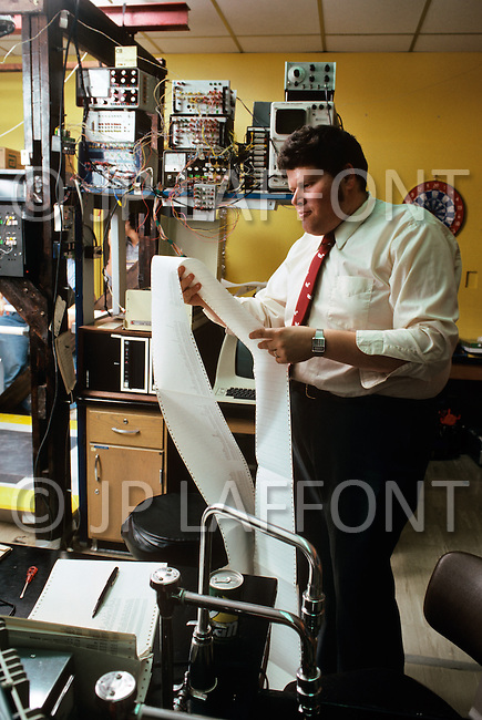 Dayton, Ohio - December 16, 1982. Dr Petrofsky monitors patients using state of the art technolog. He developed a program that enables computers to help individuals suffering from muscle malfunction, or require rehabilitation, to regain muscle control.