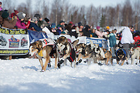 Allen Moore  runs down the chute leaving the restart of the Iditarod sled dog race at Willow, Alaska  Sunday, March 3, 2013.