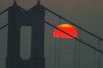 The sun filtered through the thick morning haze framed by Golden Gate Bridge, California.