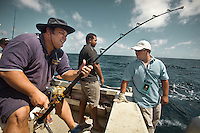 Cabinet in a boat. Going fishing with Marcus Stephen (Nauru's President, white baseball cap), Kieren Keke (Minister of Finance, black hat),  Riddel Akua (Minister for Transport and Telecommunications, with goatie beard), Dominic Tabuna (Member of Parliament, green shirt) and Rod Henshaw (Director of Media to the Government of Nauru, white shirt)...Nauru, officially the Republic of Nauru is an island nation in Micronesia in the South Pacific.  Nauru was declared independent in 1968 and it is the world's smallest independent republic, covering just 21 square kilometers..Nauru is a phosphate rock island and its economy depends almost entirely on the phosphate deposits that originate from the droppings of sea birds. Following its exploitation it briefly boasted the highest per-capita income enjoyed by any sovereign state in the world during the late 1960s and early 1970s..In the 1990s, when the phosphate reserves were partly exhausted the government resorted to unusual measures. Nauru briefly became a tax haven and illegal money laundering centre. From 2001 to 2008, it accepted aid from the Australian government in exchange for housing a Nauru detention centre, with refugees from various countries including Afghanistan and Iraq..Most necessities are imported on the island..Nauru has parliamentary system of government. It had 17 changes of administration between 1989 and 2003. In December 2007, former weight lifting medallist Marcus Stephen became the President.