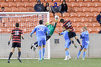 Houston, TX - Friday December 9, 2016: North Carolina Tar Heels Goalkeeper, James Pyle (1) clears the ball against the Stanford Cardinal at the NCAA Men's Soccer Semifinals at BBVA Compass Stadium in Houston Texas.