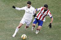 Atletico de Madrid's Arda Turan (r) and Real Madrid's Isco during La Liga match.February 7,2015. (ALTERPHOTOS/Acero) /NORTEphoto.com