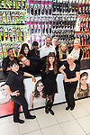 © Joel Goodman - 07973 332324 . 15 August 2013 . Paul's Hair World , Arndale Centre, Manchester , UK . The team are L-R: Kimmy Thomas , Amanda Wrench , Kristy Humphries , Josie Humphries (no relation to Kristy) , Kayann Wright , Gemma Leach , Paul Barnett , Lyndsay Purcell , Hayley Smith , Agnes Bardsley and Nikki Purcell (who IS related to Lyndsay) (all correct) . Newly reopened retail outlet for Pauls Hair World . The original outlet on Oldham Street was destroyed in a fire on 13th July 2013 . The fire claimed the life of firefighter Stephen Hunt . Photo credit : Joel Goodman