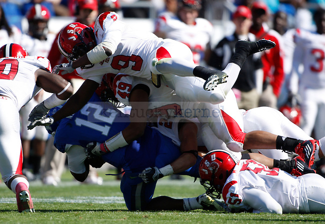 UK quarterback Morgan Newton gets tackled on a run play during the first half of UK's home game against Jacksonville State in Commonwealth Stadium in Lexington, Ky. Oct. 22, 2011. Photo by Brandon Goodwin | Staff