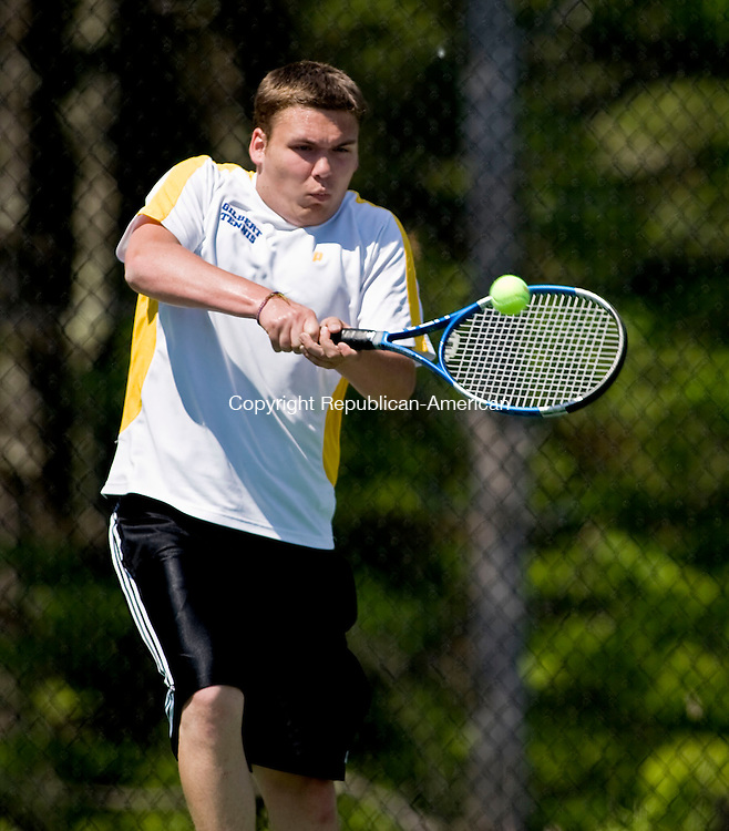 LAKEVILLE, CT - 21 MAY 2010 -052110JT11-<br /> Gilbert's Gregg Hicks returns the ball to Northwestern's Jake Zanderigo during Friday's Berkshire League Tennis Championship at the Hotchkiss School in Lakeville.<br /> Josalee Thrift Republican-American
