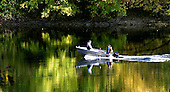Boaters glide through the morning fall colors on the Delawre River on Saturday October 25, 2003. photo by jane therese