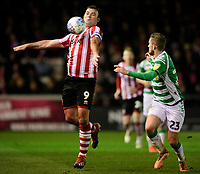 Lincoln City's Matt Rhead vies for possession with Yeovil Town's Tom James<br /> <br /> Photographer Chris Vaughan/CameraSport<br /> <br /> The EFL Sky Bet League Two - Lincoln City v Yeovil Town - Friday 8th March 2019 - Sincil Bank - Lincoln<br /> <br /> World Copyright © 2019 CameraSport. All rights reserved. 43 Linden Ave. Countesthorpe. Leicester. England. LE8 5PG - Tel: +44 (0) 116 277 4147 - admin@camerasport.com - www.camerasport.com