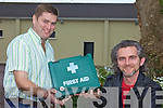 FIRST AID: Members of the Ballyfinnane Community Centre committee, Peter O'Connor and Maurice Galwey announcing details of first aid classes and other events to be held there in the coming months.