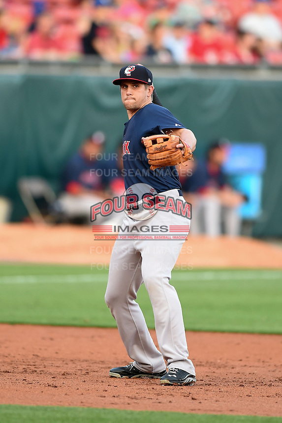 Pawtucket Red Sox third baseman Garin Cecchini (3) warmup throw to first during a game against the Buffalo Bisons on August 23, 2014 at Coca-Cola Field in Buffalo, New  York.  Buffalo defeated Pawtucket 15-2.  (Mike Janes/Four Seam Images)