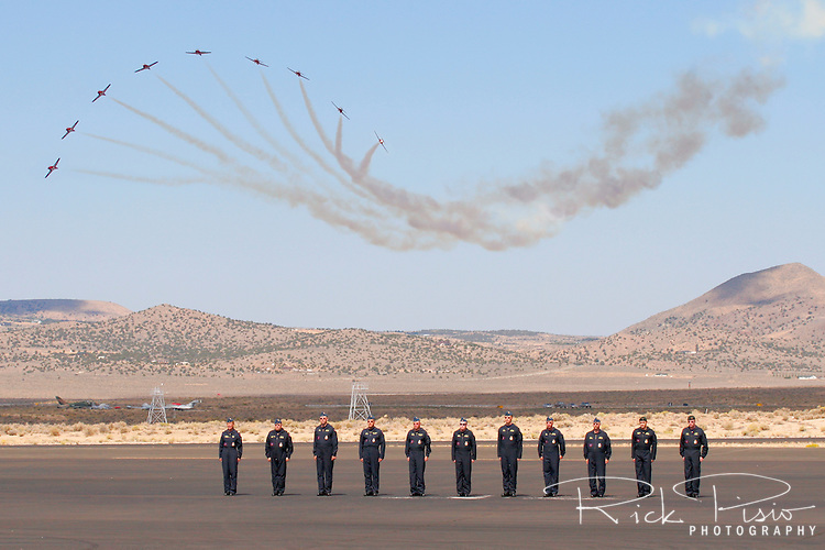 The ground crew of the Royal Canadian Air Force Snowbirds stands at attention as the aircraft of the demonstration team break from the Nine Plane Line Abreast formation during a flight demonstration at the 2007 Reno Air Races. The Snowbirds are part of the 431 Air Demonstration Squadron and are based out of Moose Jaw, Saskatchewan.The team has flown the Canadian built CT-114 Tutor jet since 1971. Photographed 09/07