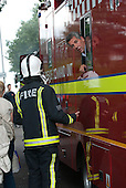 Kingston upon Thames, England. Command Staff fireman talking to a fireman from the command unit.