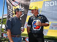 May 21, 2017; Topeka, KS, USA; NHRA top fuel driver Steve Torrence (left) with Brian Corradi during the Heartland Nationals at Heartland Park Topeka. Mandatory Credit: Mark J. Rebilas-USA TODAY Sports