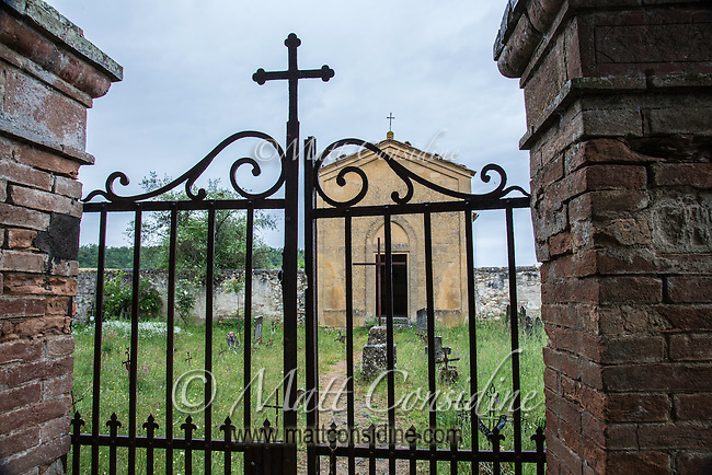 The gates at the graveyard chapel for the abbey of Sant'Anna in Camprena featured when Willem Defoe arrives at the abbey in the film The English Patient. (Photo by Matt Considine Travel Photographer)